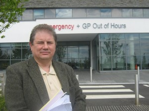 Cllr Enright outside the new Downe Hospital A&E