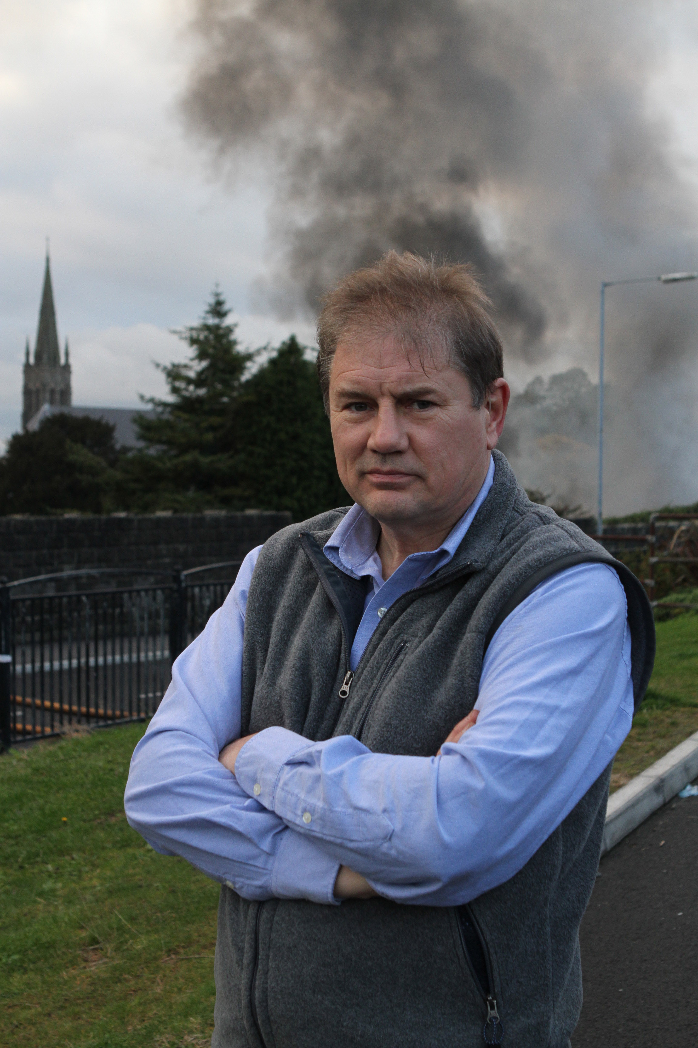 Cllr Cadogan Enright on the scene as the old surgery in Pound lane burns