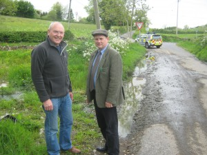 Housing Executive Create a Stink at Wallace Hill Road Lawrence Kirk and Cllr Cadogan Enright at site of sewerage spill in Wallace Hill Road